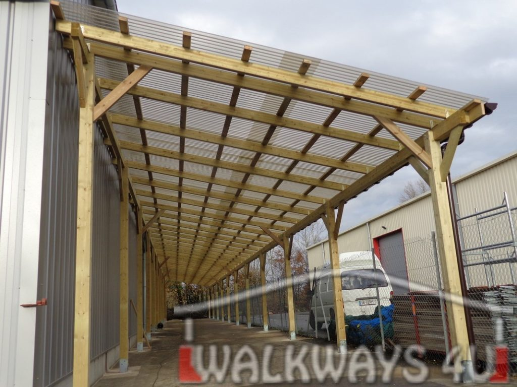 Custom built commercial buildings. Constructions from laminated wood. Covered walkways.
