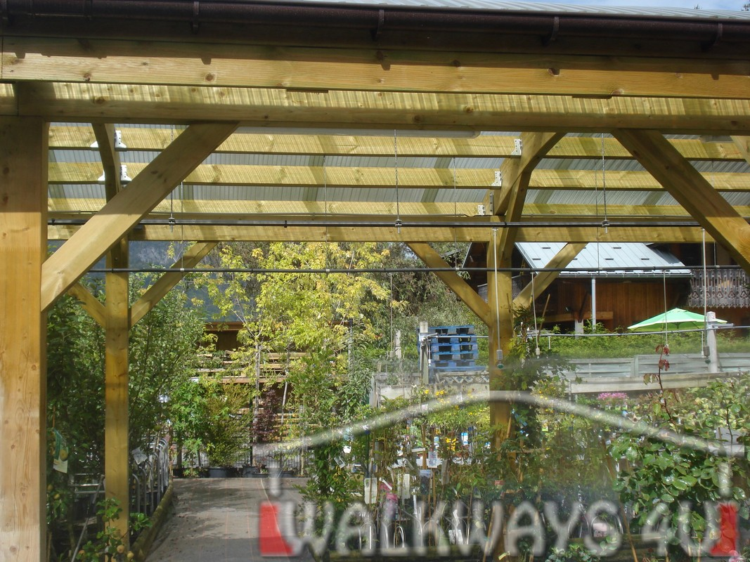 Covered canopies, pathways and walkways made from high quality laminated wood. Design, delivery and assembly