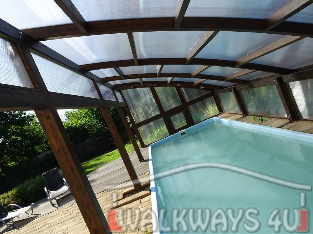 Photo 6. Szklana zabudowa basenu drewniane zadaszenia taras?w i oran?erii