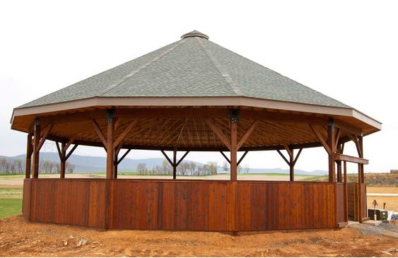 Photo 23. Fully covered lunge pen for lungeing or working horses. The fully covered roof is constructed with laminated wood