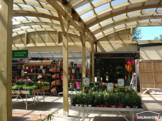 Image No  06.  Passages couverts, espaces commercial couvert, constructions en bois lamelle - colle, toitures, fermetures en bois